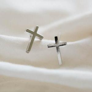 platinum plated cross stud earrings..