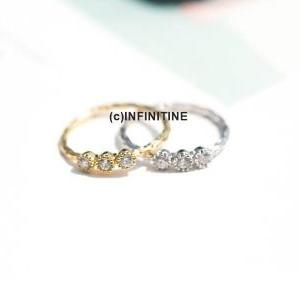 Cz knuckle ring with 3 cubic zircon..